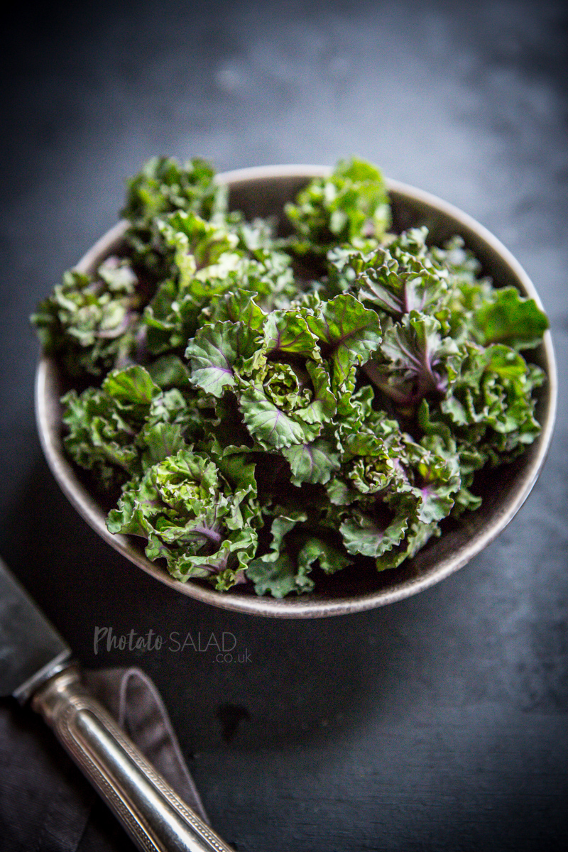 Fresh Green & Purple Kalettes in a grey bowl with dark background