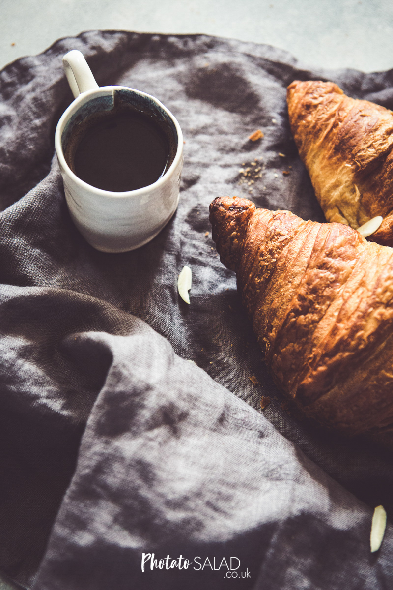 Croissants and Black Coffee on a grey linen napkin