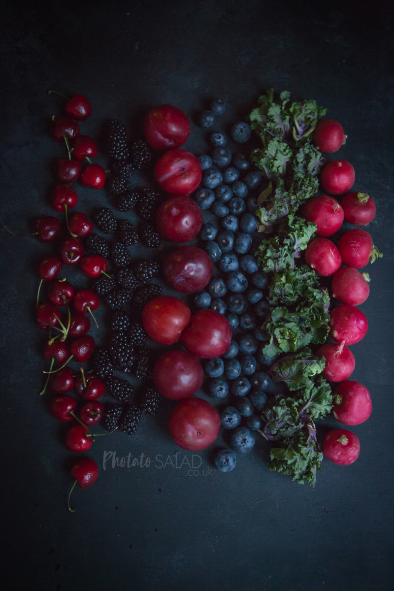 Flatlay of Summer Fruits and Berries on a dark background
