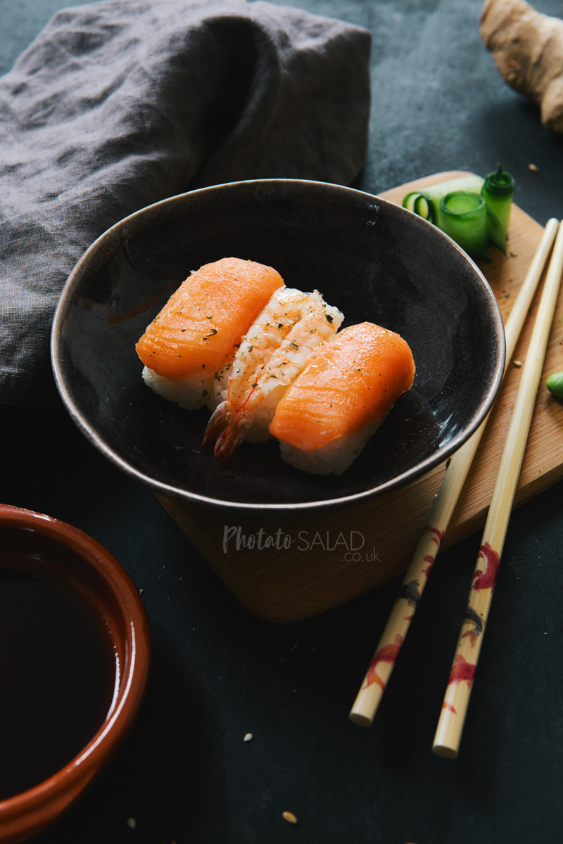 Salmon & Prawn Nigiri Sushi in a bowl with chopsticks